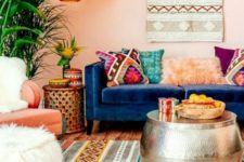 a bright Moroccan living room with colorful textiles and patterns, a hammered coffee table and lamps