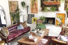 a chic Moroccan inspired living room with plants, printed and patterned textiles and rugs and lamps