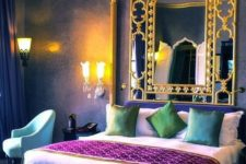 a colorful Moroccan bedroom in purple, blue and emerald, with gold touches and a framed mirror is a fersh take on Eastern bedrooms