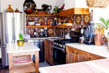 a colorful mosaic tile backsplash, a wicker lampshade and wooden cabinets for a boho feel