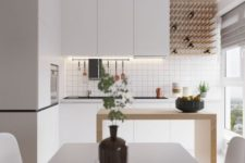 a minimalist white kitchen with built-in lights, a wine bottle rack, a minimal wooden kitchen island and a white dining set