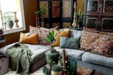a modern Moroccan living room with Moroccan lamps, a patterned coffee table and pillows and rugs