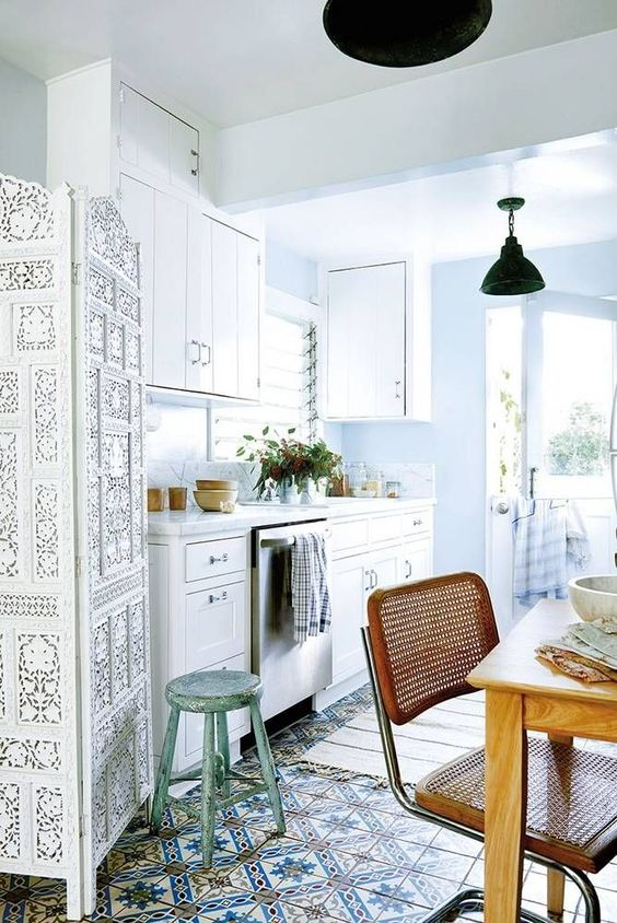 a mosaic tile floor, a wooden chair and a Moroccan style white space divider for a boho chic look