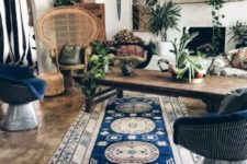 a welcoming Moroccan living room with a pendant lamp, wicker chairs and patterned textiles