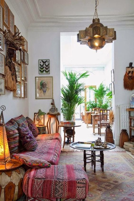 a welcoming and relaxing boho living room with Moroccan lamps, tassels and colorful textiles