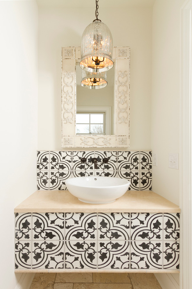 an antique glass pendant light, a built-in vanity clad with Moroccan black and white tiles and a bowl sink  (w.b. builders)