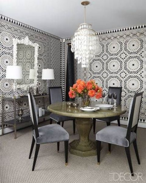 give your dining space a Moroccan twist with such tile walls, a beautiful mother of pearl chandelier and a mirror in a refined frame