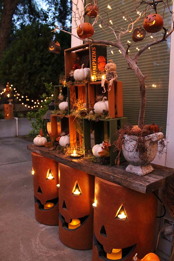 nested crates and pottery pumpkins with led candles and string lights