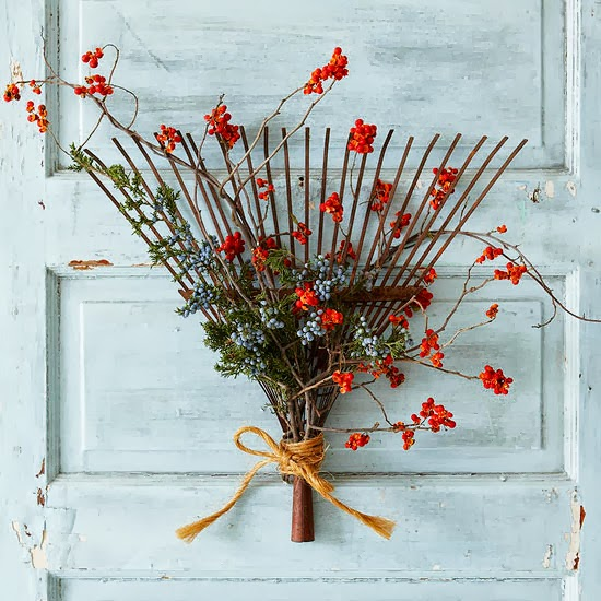 Repurpose old rakes and make them by adding twigs with dried berries.