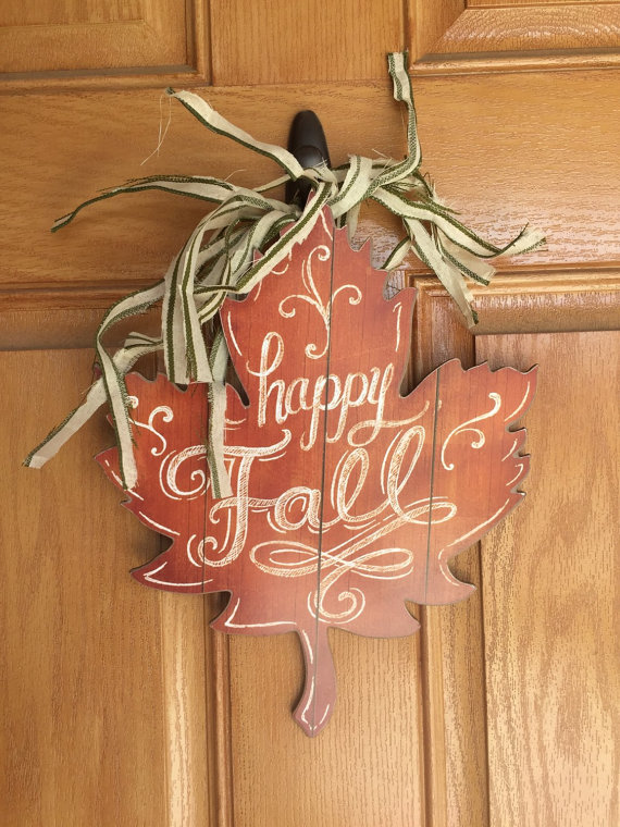 Rustic fall leaf door hanger could be made from a single piece of wood.