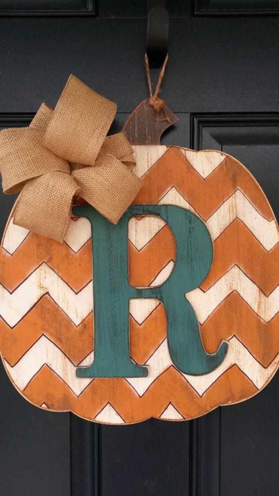 Make a faux monogrammed pumpkin from a wood board.