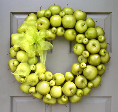 If you want a splash of freshness, hang a green apple wreath on your door. It'd contrast with traditional Fall colors really well.