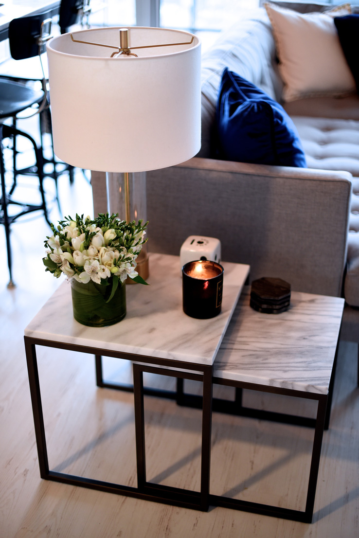 Nesting tables is a quite practical solution for small rooms. They usually come in sets of two or three, stack together, but can be pulled out to provide lots of tabletop surface when necessary.