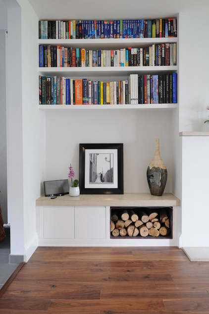 Niches are perfect for organized built-in storage solutions. Even simple shelves looks great there.