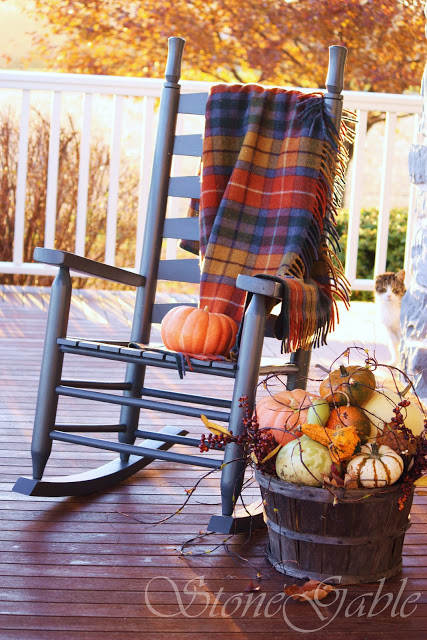 Plaid blankets are perfect additions to porch' seating furniture when evenings become colder and colder.