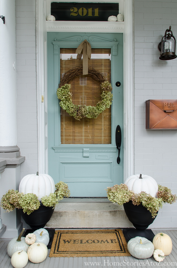 Light toned pumpkins are perfect for a subtle monochrome porch decor.