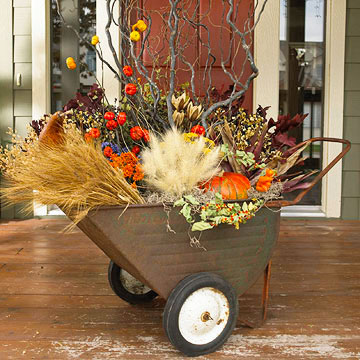 Repurpose a vintage wagon cart and fill it with products of Autumn for a  mobile centerpiece