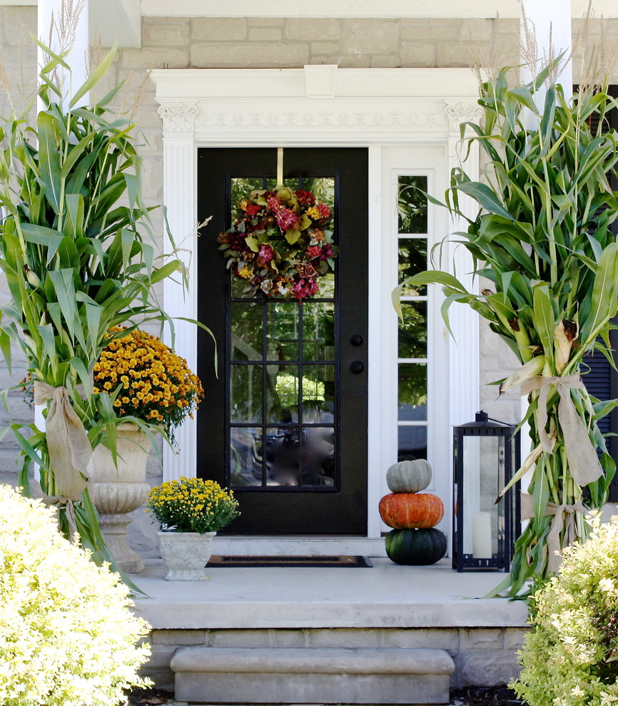 front door entry decor ideas. add several pumpkins, lanterns, cornstalks and late blooms for subtle fall porch decor. front door entry decor ideas d
