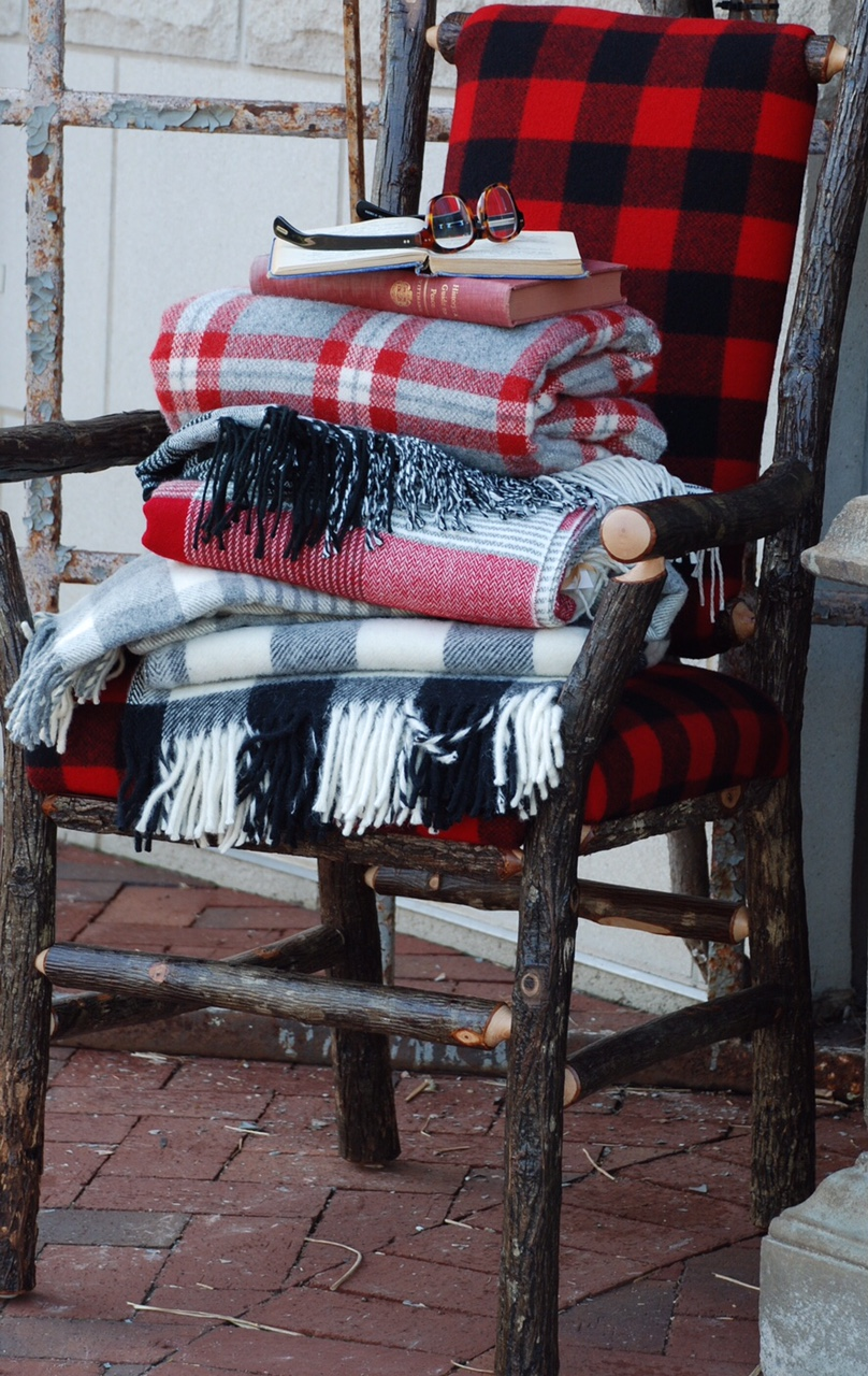 Throw a plaid blanket or a pillow over your porch furniture to make it cozy.