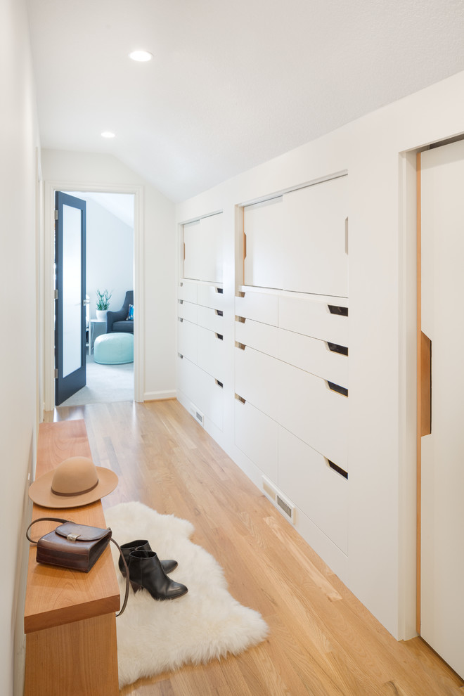 Built-in drawers is another way to turn your hallway into a storage mecca. Lots of folded clothes, shoes, jewelry and other small things could be stored there.