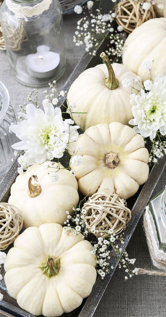 a beautiful fall centerpiece of a dark wooden box, vine balls, mini flowers, pumpkins and larger blooms is wow