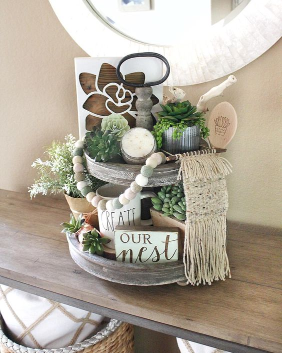 a fall rustic and boho wooden tand with succulents, greenery, a sign, a candle and a macrame decoration