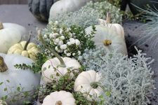 a neutral box with pumpkins, pale greenery, berries, gourds and other stuff is a beautiful arrangement for the fall