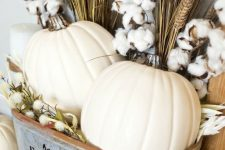 a rustic fall arrangement of pumpkins, cotton and wheat bundles in a metal bathtub is a lovely idea for the fall