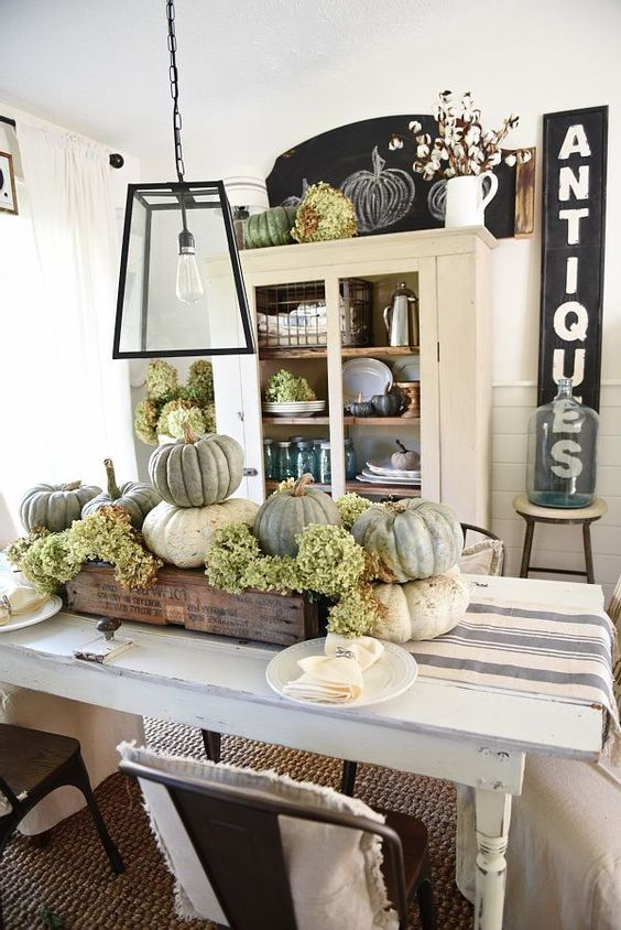 a stained crate with heirloom pumpkins and green hydrangeas for a rustic vintage fall centerpiece