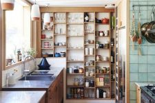 a wall-mounted storage unit with many open shelves takes an awkward wall and is very creative idea