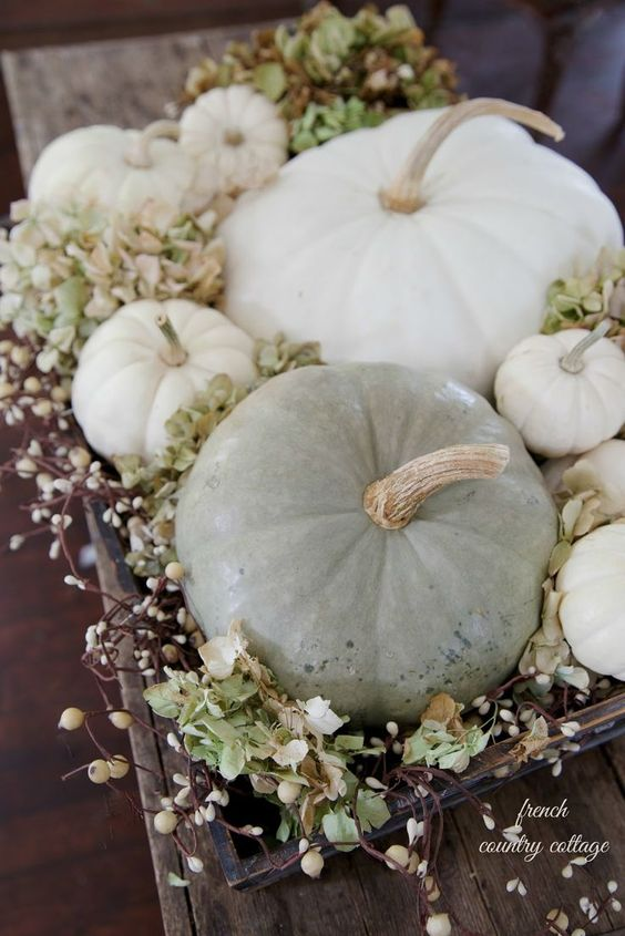 a wooden tray with greenery, blooming branches and neutral pumpkins is a natural and chic fall centerpiece or arrangement