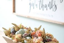 a wooden tray with pastel pumpkins and dried blooms is a chic rustic centerpiece or just an arrangement