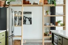 an airy wooden storage unit doubles as a space divider is a cool idea for any modern space