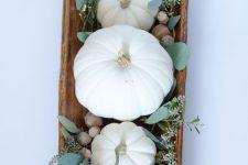 an easy white pumpkin and silver dollar eucalyptus centerpiece in dough bowl can be quickly made