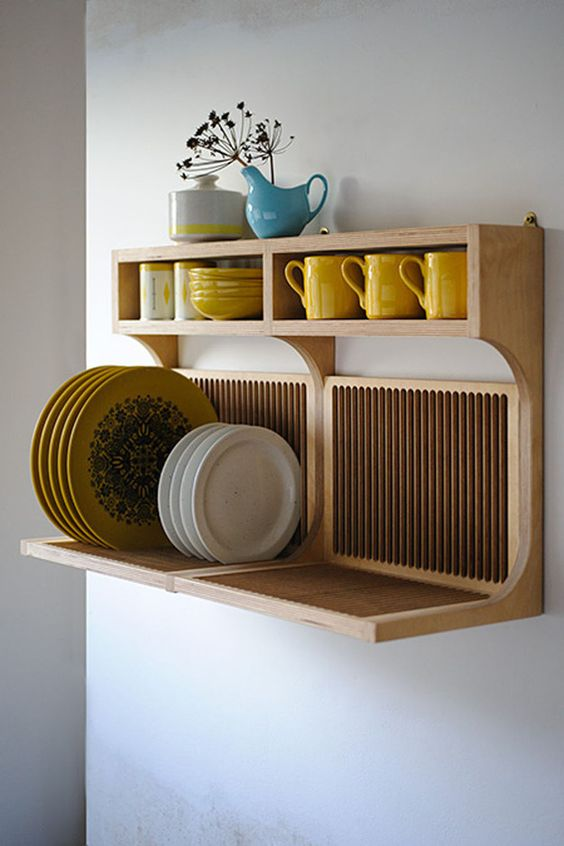 an elegant wooden shelf for storing plates and mugs and cups at the same time is perfect for a modern kitchen