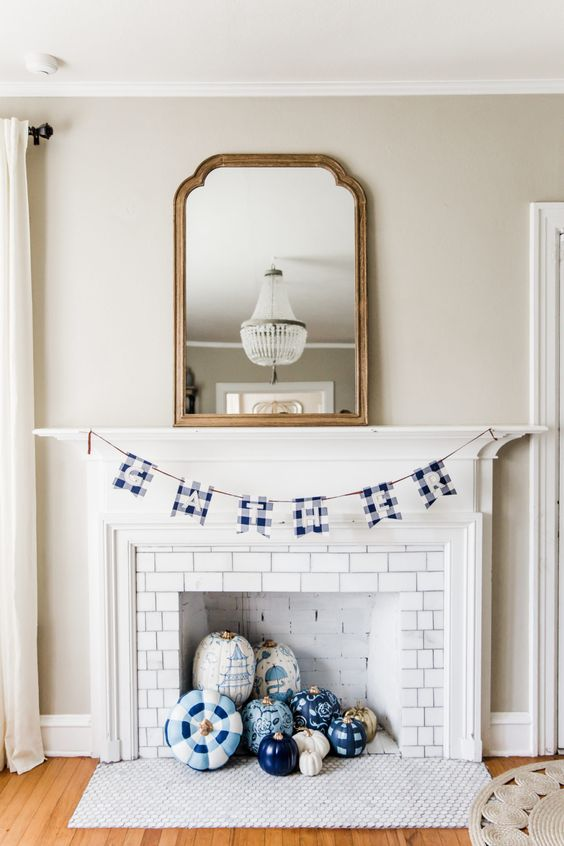 blue, navy and white painted and stenciled pumpkins and a plaid garland will bring a non-traditional touch of color and print to the space