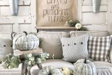 chalk paint pumpkins, greenery and white blooms to create a vintage farmhouse space with neutral decor