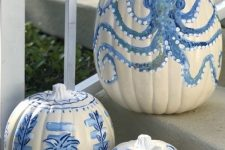 coastal pumpkins in white and blues – with various painted motifs – are great for fall coastal decor, outdoors and indoors