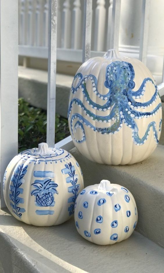 coastal pumpkins in white and blues - with various painted motifs - are great for fall coastal decor, outdoors and indoors