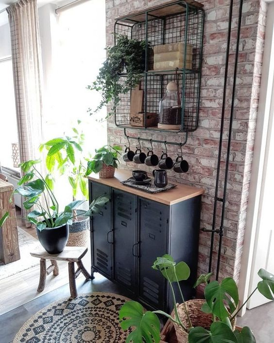 industrial black metal cabinets with a wooden countertop and a wire open shelf on the wall for storage