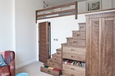 ingenious small bedroom design where under bed storage is take to another level with drawer-stairs and a matching wardrobe