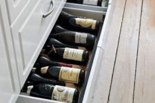 large flat drawers in the lower part of the kitchen island are great for storing wine and other drinks that don't require fridges