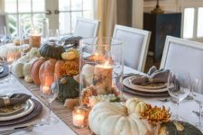 natural fall table decor with candles, pumpkins, blooms and tree stumps and branches is a cool idea for the fall