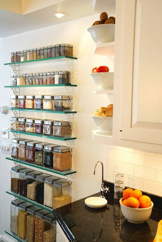 open glass shelves for storing spices and other food in containers and some open shelves on the side of the cabinet