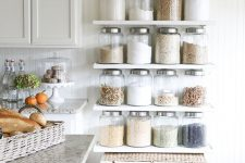 open shelves and a large woven chest are ideal for a modern farmhouse kitchen and provide much storage space