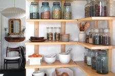 open shelves taking an awkward corner allow you using the whole space you have at hand