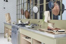 open storage cabinets and railing with pans and pots hanging over them are nice for every kitchen