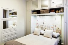 perfect small bedroom design where the bed has a cozy built-in feel, thanks to the recess created by the shelving