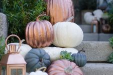 place some painted and non-painted pumpkins on the steps and some candle lanterns to make them look fall-like
