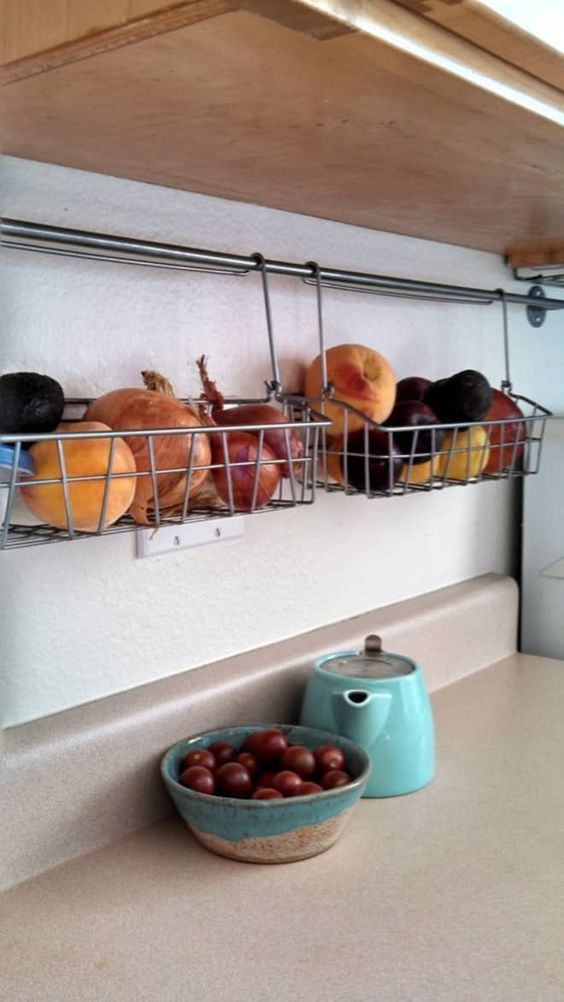 railing with wire boxes that can store anything, from food to mugs and plates